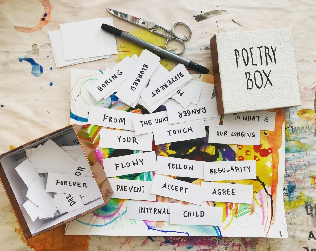 An expressive arts workshop focused on making customized poetry boxes.
